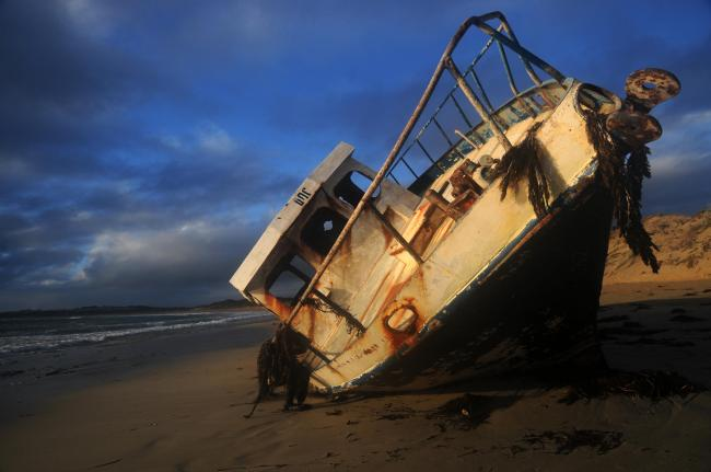 Wrecked fishing boat washed up on remote Pondalowie Bay, Innes National Park, Yorke Peninsula, South Australia