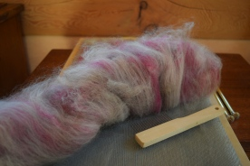 Comb fiber into carding cloth then lift off batt
